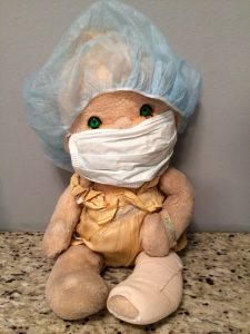 """The twins' doll, Patooty, even """"awoke"""" with a bandage after surgery"""