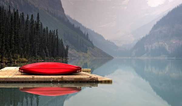 Red Canoes on a Scenic Lake