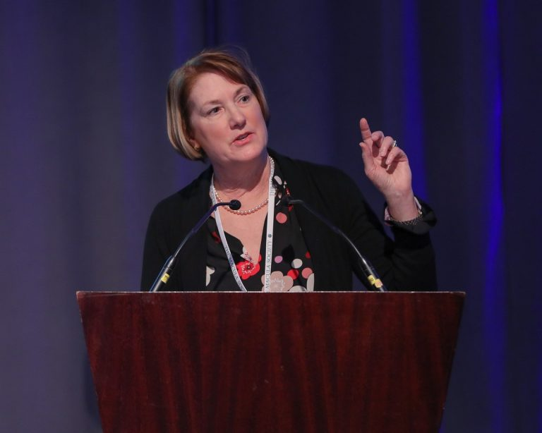 Barbara Blodi, MD speaks at conference.