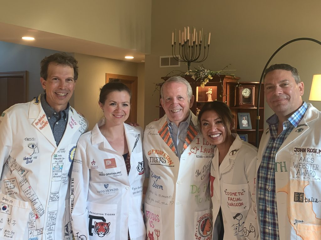 Pictured from left to right: Drs. Mark Lucarelli, Suzanne van Landingham, Richard Dortzbach, Cat Burkat and John Rose. On Saturday, July 20, the oculoplastics team and alumni celebrated one of the time-honored traditions of the  UW-Madison Oculofacial fellowship, the White Coat Celebration.